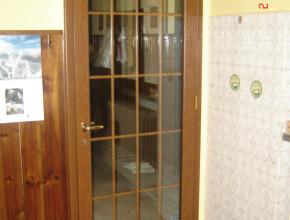Porta interna in alluminio ciliegio. Vetro all'inglese con bacchette interno vetro legno
